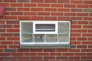 Glass block basement window with an air vent