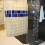 Glass block shower wall with stripe of blue glass blocks