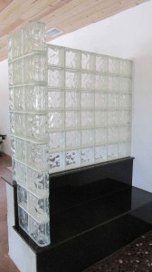 Glass block shower wall on granite bench seat