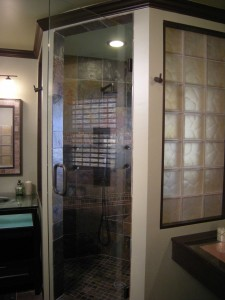 Glass block shower wall insert using colored frosted glass blocks