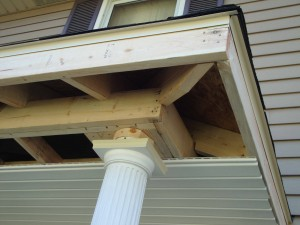 Front Porch Roof Addition during construction with fiberglass columns and vinyl soffit