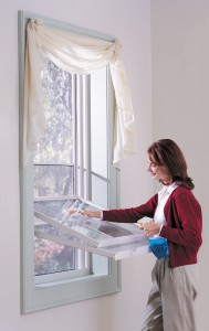 White double hung vinyl replacement window tilts in for easy cleaning
