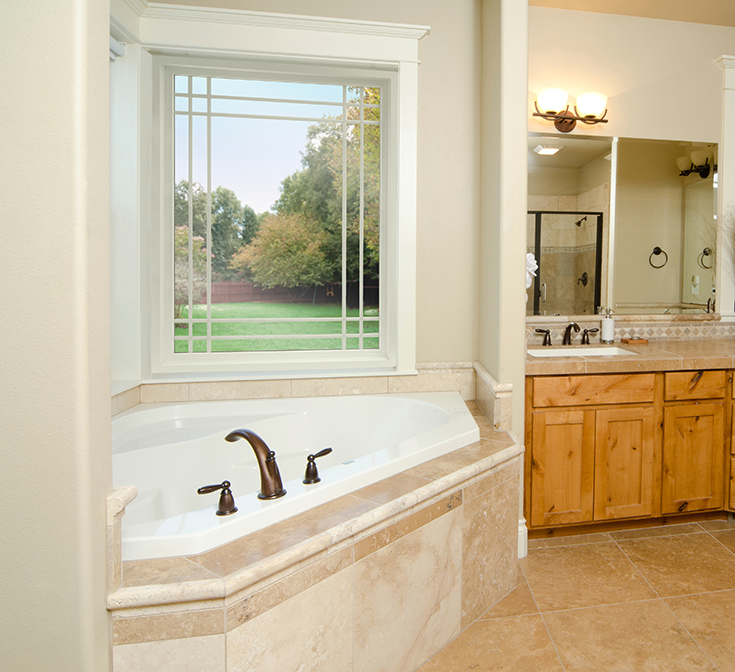 Advantage 3 prairie style picture window above a soaking tub in a Cleveland master bathroom | Innovate Building Solutions #Soakingtub #Picturewindow #ClevelandWindow