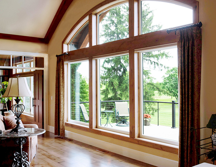 Advantage picture window with shaped windows at the top Cleveland | Innovate Building Solutions #Picturewindow #LivingRoom #GreatRoom