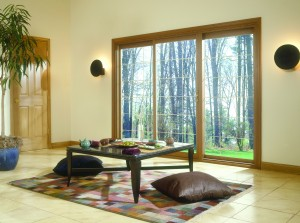3 Panel Sliding Patio Door with Wood Veneer in a Family Room
