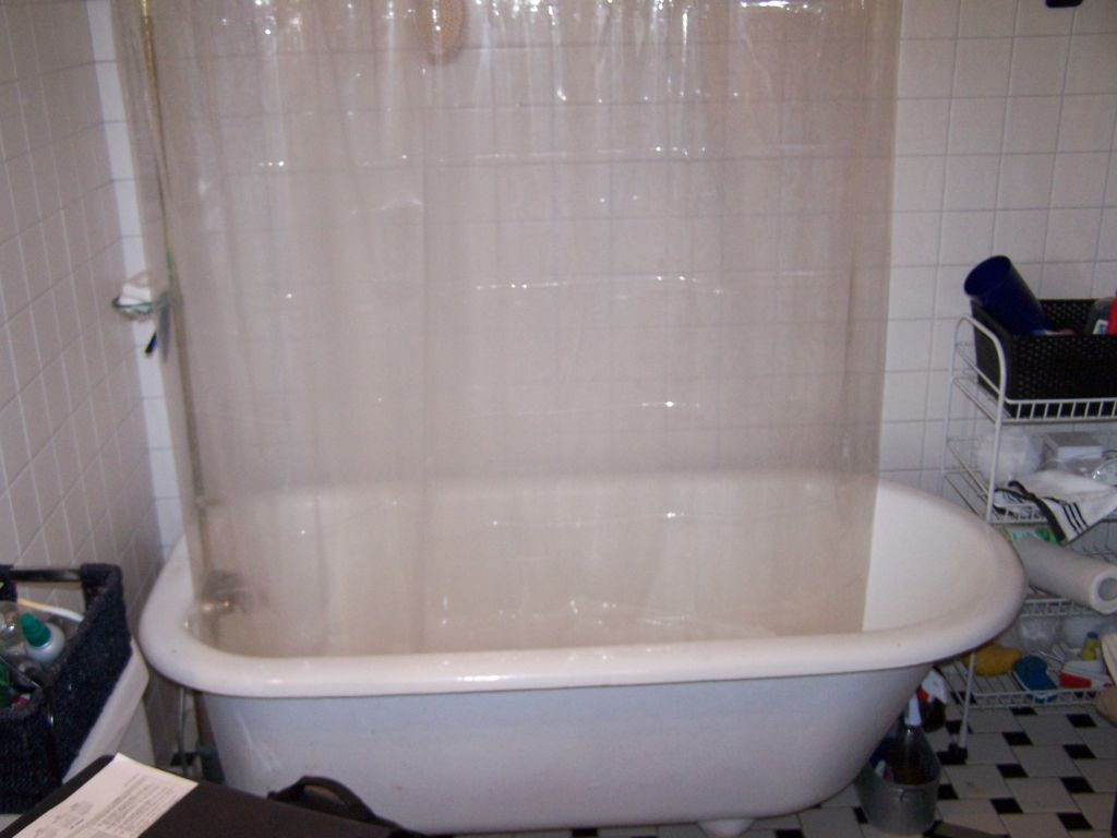 before clawfoot tub with old shower rod u0026 curtain
