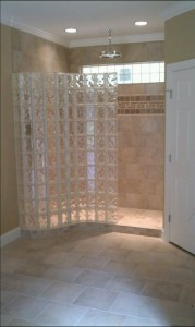 Pool house room addition with serpentine glass block shower wall