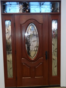 Fiberglass front entry door and transom with decorative glass