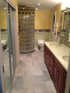 Bathroom remodeling with a curved glass block wall