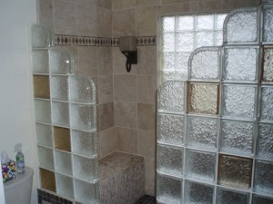 Step down glass block shower with colored glass blocks