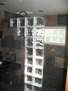 Glass block wall with top finished with end blocks