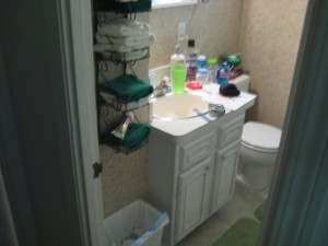 Before small bath remodeling cramped bathroom with a cabinet
