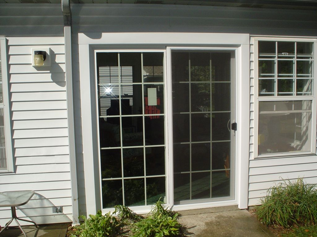 Sliding glass patio door replacement for a storm door for Sliding patio windows