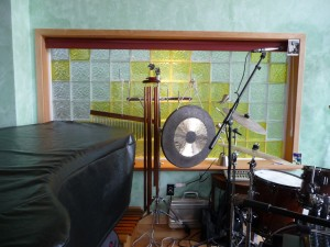 Music studio with vinyl framed lemon colored glass blocks encased trimmed in wood
