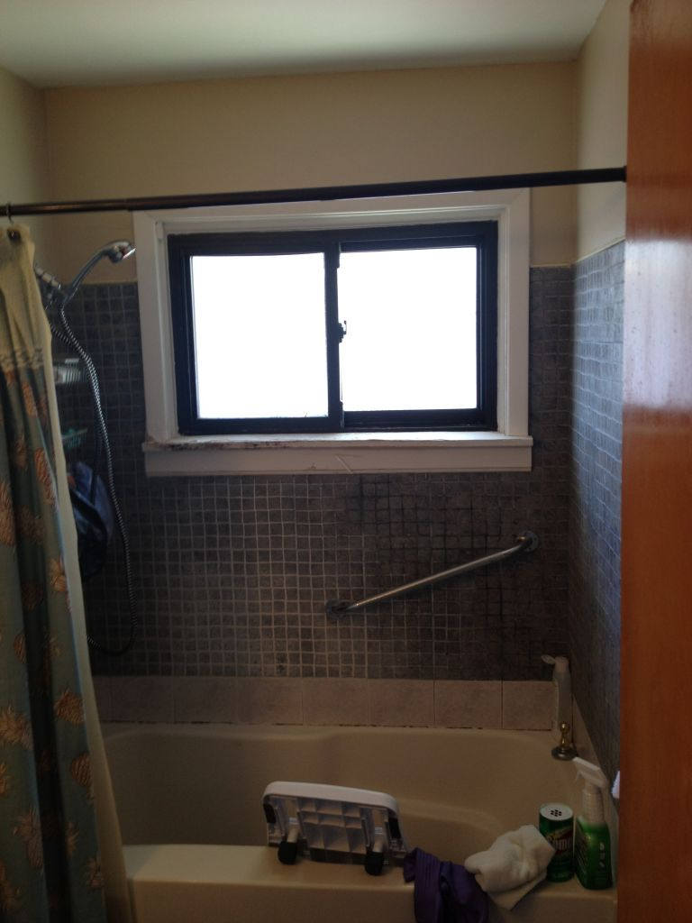 roll in barrier free shower using a va grant cleveland columbus ohio before old tub with a high rail to step over deteriorated wood window sill