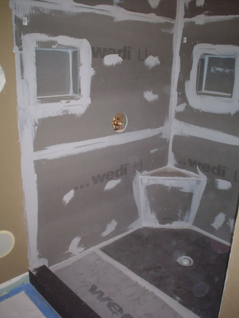 wedi waterproof shower base and wall backer system before tile
