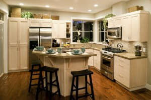Kitchen remodeling with an island for entertaining and stainless steel appliances