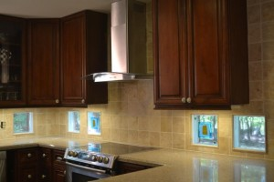 Glass tile blocks used as a kitchen backsplash to add style and natural light from the outside