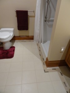 Comfort height toilet decorative grab bar and higher outlets in accessible guest bathroom UDLL home columbus ohio