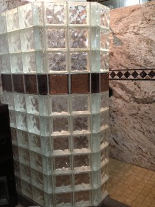 Decorative colored glass block shower wall with Sentrel wall surround system
