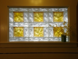 Colored and frosted glass blocks using 4 x 8 and 8 x 8 blocks in a bath window