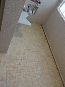 Accessible Bathroom Design with barrier free tile shower base quick drain fold down seat and shampoo niches