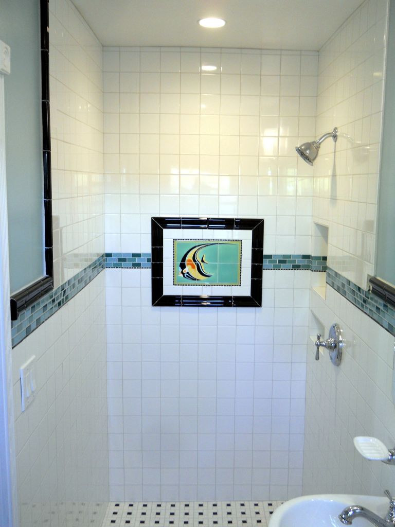 Colored glass block shower in a small bathroom renovation for Glass tile border bathroom ideas