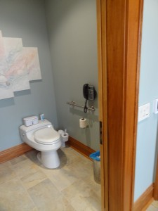 Comfort height toilet with a decorative grab bar in a wide turning radius toilet room in Columbus Ohio