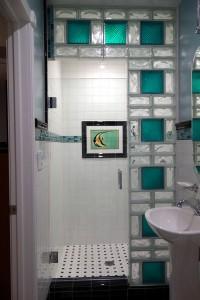 Glass block shower wall using 8 x 8 colored glass blocks and 4 x 8 alternating blocks
