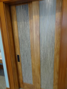 Glass privacy doors for a toilet room in Columbus Ohio