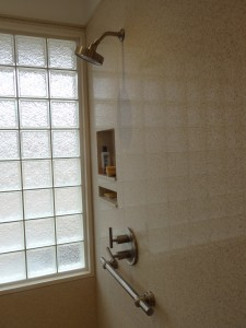Universal design shower with a glass block privacy window