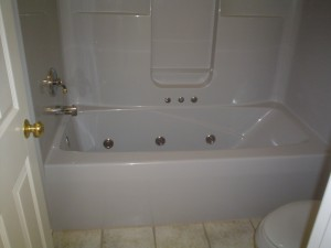Before image - jetted tub with fiberglass wall surrounds