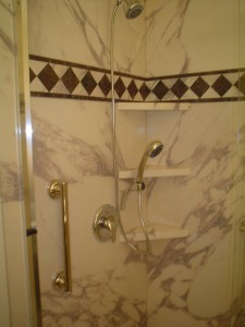 Hand held shower, 3 corner shelves, Sentrel interior wall panes and grab bar in Cleveland Ohio project