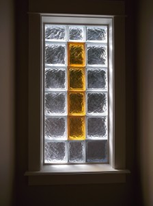 Clear and Colored Glass Blocks around a toilet room window