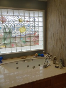 Decorative glass block mural using an Icescape pattern border for privacy and style