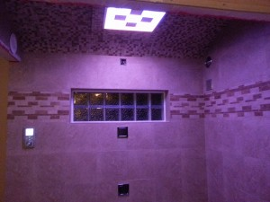 Kohler shower system with LED lights body sprays and rain shower head and glass block shower window