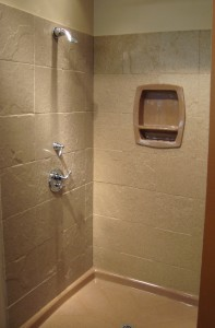Solid surface shower walls and base
