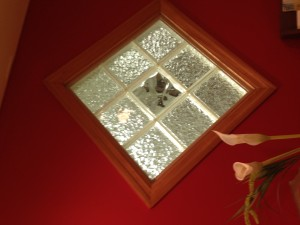 Glass block panel set on an angle with a different pattern border