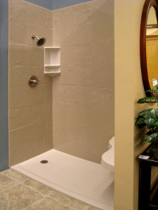 Solid surface shower base with slate design walls and corner caddy