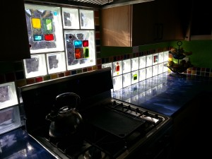 Kitchen backsplash with artistic glass tile blocks for light and color