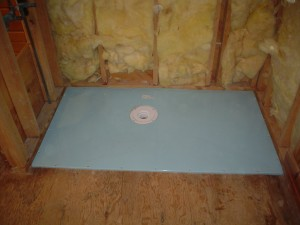 Roll in shower base during installation set on joists