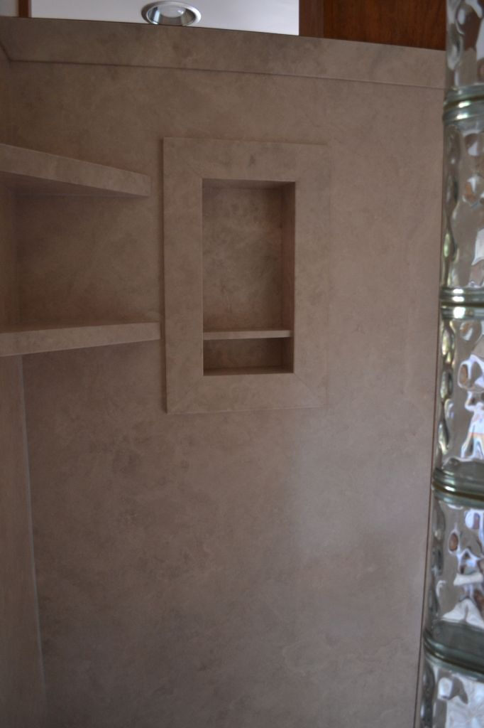Glass block walk in shower with diy interior shower wall for Glass wall panels bathroom