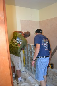 Installation of thinner series curved glass block shower wall sections by Stu and Barry