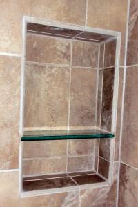 Soap and shampoo niche with glass shelf