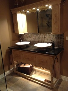 An antique buffet table changed into a decorative bathroom vanity