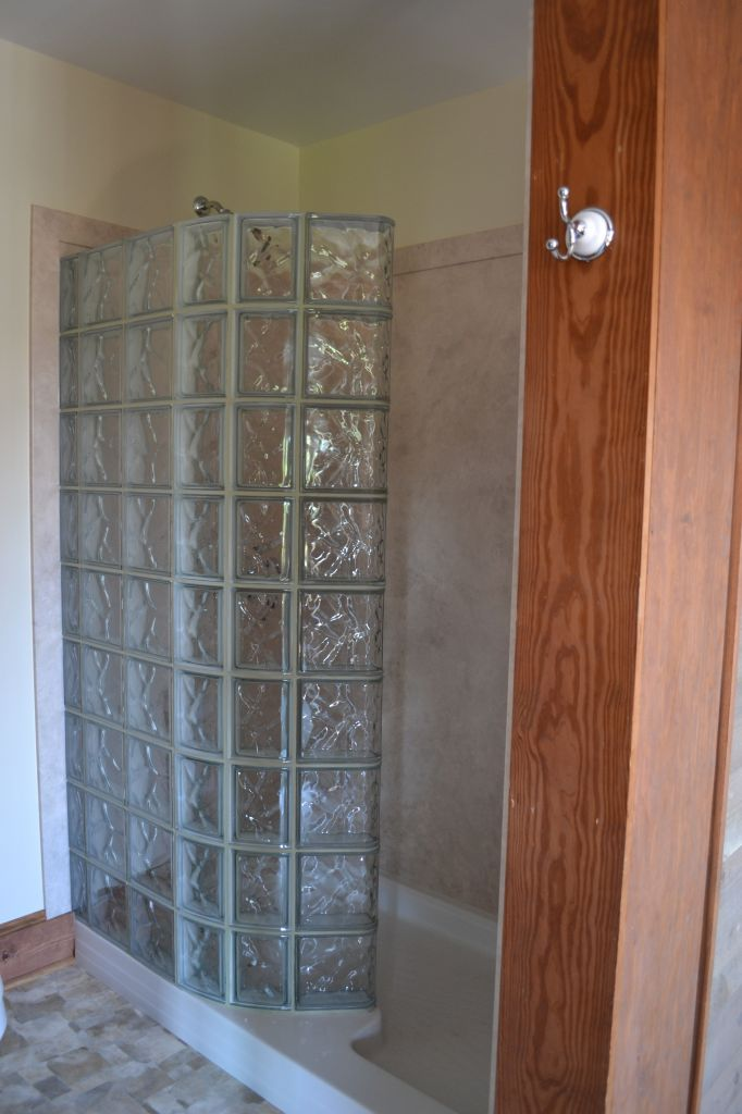 Glass block walk in shower with DIY interior shower wall panels ...