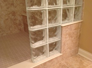 """16"""" high glass block step going from bench seat to shower curb"""