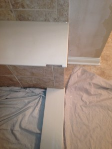 Shower bench seat notched out to accomodate glass block joints