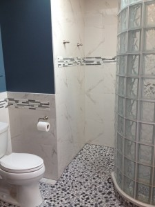 Glass tile accent and tile in toilet area