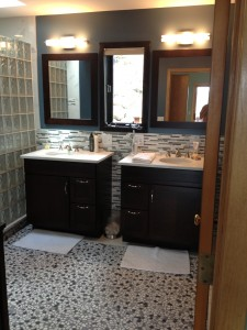 His and hers bathroom vanities to match master bedroom woodwork